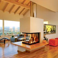 cheminée loft centrale orange et inox foyer insert ruegg atre et loisirs