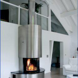 cheminée loft metal inox et granit noir foyer insert rond ruegg atre et loisirs