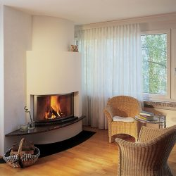 cheminée moderne d'angle galbée foyer ruegg atre et loisirs